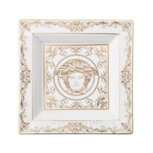 "Versace's expressive ""Medusa Gala"" 22 cm Square Dish displays swirling gold and pearl white baroque ornaments encasing the glorious Medusa head."