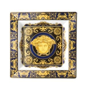 "Versace's sumptuous ""Medusa Blue"" 22 cm square dish emphasises the precious Versace Medusa head with royal blue and gold accents."