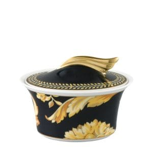 "Versace's refined ""Vanity"" sugar bowl brings to life the baroque acanthus decor through the perfect blend of glamorous blacks and golds."