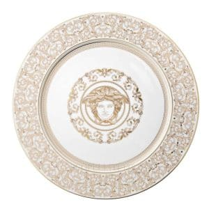 "Versace's amazing ""Medusa Gala"" 30 cm Service Plate showcases elaborate whites and golds arabesque motifs and a finer Greek key encircling the enchanting mythical figure."