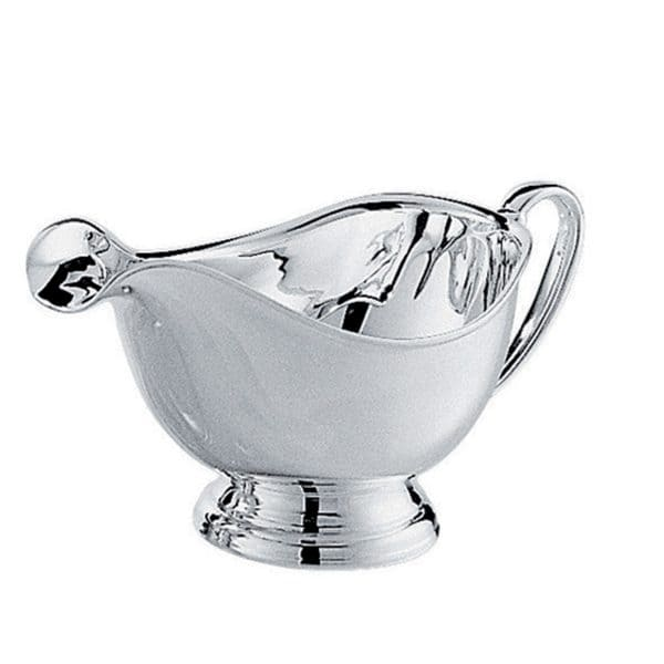 Albi Silver Plated Gravy Boat recalls the elegant and straight lines and single nave of Albi Cathedral in the homonymous French town located between Toulouse and Bordeaux. The Silver Plated Albi medium gravy boat adds refinement and playful modern elegance to any meal. The highly polished vessel features a pedestal with an ornamental grooves and slightly stylized shaped handle, an ideal grip for serving out of all types of sauces.