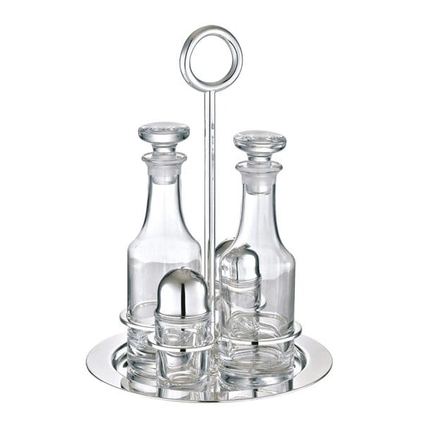 Vertigo oil and vinegar cruet set includes two crystal bottles with stoppers and a Silver Plated stand that also has compartments to hold salt and pepper shakers. The Vertigo bold ring motif with its slightly tilted twist playfully adorns the vertical handle of the cruet.