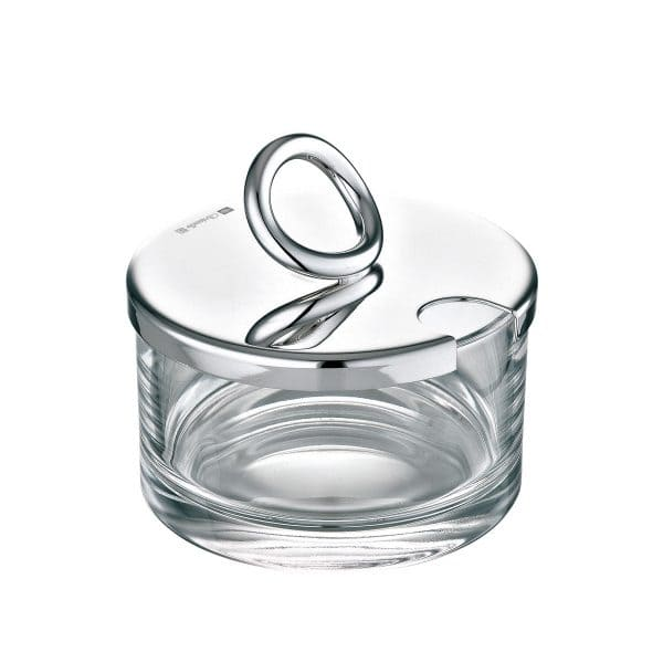 Vertigo Silver Plated Cheese or Jam Dish will playfully adorn an elegant table with this dainty glass dish crowned by the iconic asymmetrical and thick Vertigo Style ring joyfully askew on the mirror polished silver plated lid.