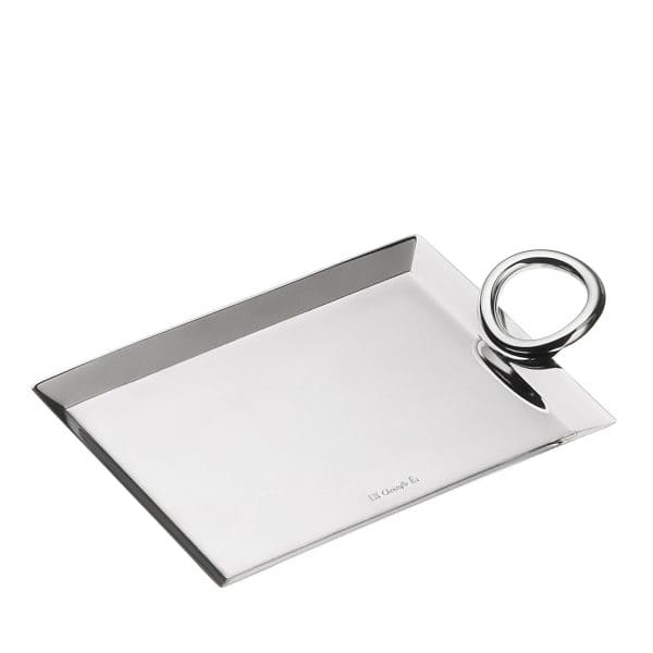 Vertigo Silver Plated Business Card Tray with the asymmetrical, thick Andrée Putman style handle proves that modern and playful elegance is not relegated to the dining room or kitchen only. The dazzling effect of the mirror polished rectangular base and of the refined Christofle signature in contrast with the bold sensual curves of the slightly tilted single ring can  spruce up office habitats and make a great gift for endless occasions.