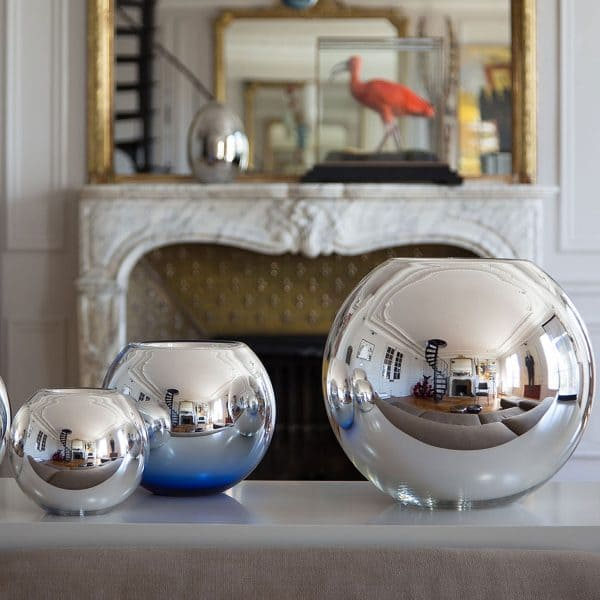 UNI silver polished rounded vase is made with double sided metallized glass and silver and each piece is handmade and manufactured in a small workshop of mouth-blown glass. The contemporary shape brings elegance and sophistication to any room in your home.