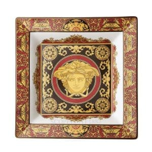 "Versace's hypnotic ""Medusa"" 22 cm square plate is a true eye catcher with the arising golden mythical enchantress."
