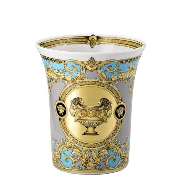 "Versace's enthralling ""Prestige Gala Le Bleu"" 18 cm flared Vase features a platinum, gold and light turquoise celebration of the French Maison's print ""Le Vase Baroque"" and Medusa Head."