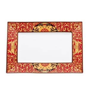 "Versace's astonishing ""Medusa"" Rectangular Platter is an outburst of expressive swirling red and gold baroque ornaments and cheerful cherubs and hunting scenes."