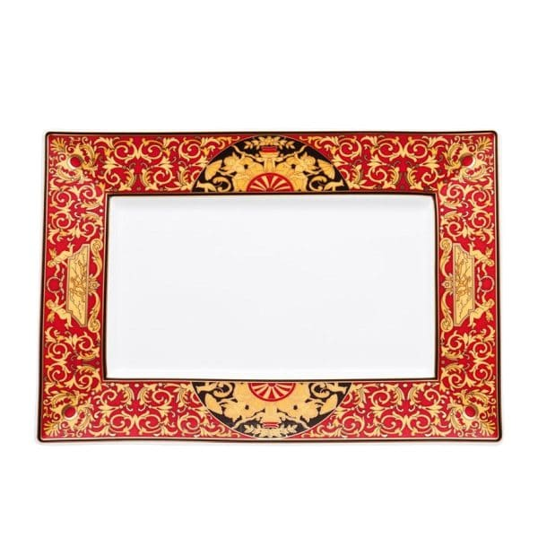 """Versace's astonishing """"Medusa"""" Rectangular Platter is an outburst of expressive swirling red and gold baroque ornaments and cheerful cherubs and hunting scenes."""
