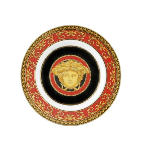 "Versace's hypnotic ""Medusa"" 18 cm round plate is a true eye catcher with the emerging golden mythical enchantress."